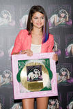 th 63152 SelenaGomezacceptsagoldrecordforheralbumWhenTheSunG 0024 123 255lo Selena Gomez   Receives gold record for When The Sun Goes Down, Four Seasons Hotel, Jan. 26, 2012